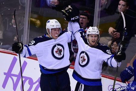 Nov 19, 2018; Vancouver, British Columbia, CAN; Winnipeg Jets forward Patrik Laine (29) celebrates his goal wiwth forward Kyle Connor (81) against Vancouver Canucks goaltender Jacob Markstrom (25) (not pictured) during the third period at Rogers Arena. Mandatory Credit: Anne-Marie Sorvin-USA TODAY Sports