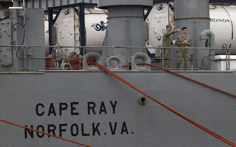U.S. military personnel stand on the deck of American ship MV Cape Ray as it is docked at Naval Station in Rota, Spain, on Thursday Feb. 13, 2014. The American ship arrived on Thursday at the naval base of Rota on Spain's southwestern coast used by the U.S. to resupply ahead of an unprecedented mission to collect and destroy mustard gas, raw materials for sarin nerve gas and tons of other highly toxic chemicals that form part of Syria's chemical weapons program. After leaving Spain, the Cape Ray's next port of call is expected to be Gioia Tauro in southern Italy, where experts from the Organization for the Prohibition of Chemical Weapons say it will take on board 560 metric tons of chemicals that have been transported from the Syrian port of Latakia in two cargo ships from Denmark and Norway. (AP Photo/Miguel Angel Morenatti)