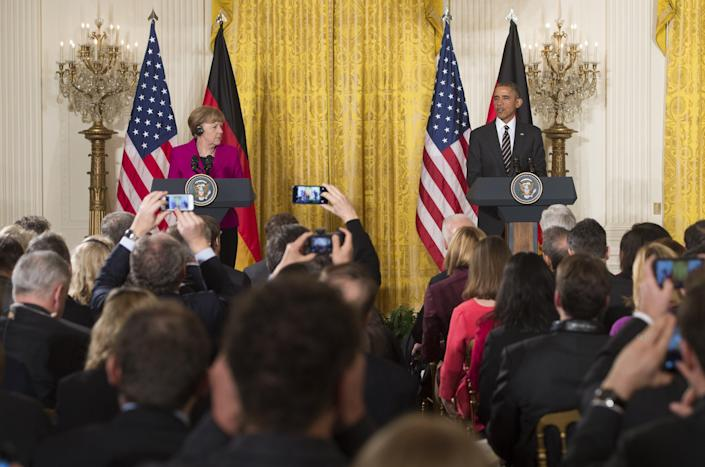 US President Barack Obama and German Chancellor Angela Merkel hold a joint press conference at the White House in Washington, DC on February 9, 2015 (AFP Photo/Saul Loeb)