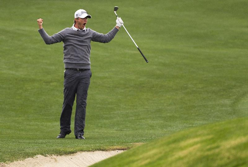 Matt Jones celebrates after chipping in for birdie on a playoff hole against Matt Kuchar to win the Houston Open golf tournament on Sunday, April 6, 2014, in Humble, Texas. (AP Photo/Patric Schneider)
