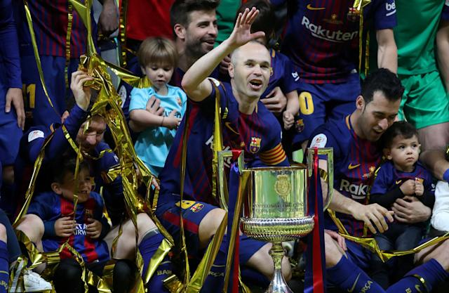 FILE PHOTO: Soccer Football - Spanish King's Cup Final - FC Barcelona v Sevilla - Wanda Metropolitano, Madrid, Spain - April 21, 2018 Barcelona's Andres Iniesta, Lionel Messi, Gerard Pique and Sergio Busquets celebrate with the trophy after winning the final REUTERS/Susana Vera/File Photo