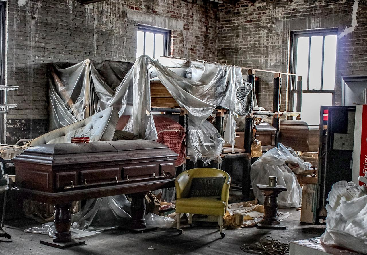 <p></p><p><span>An abandoned funeral home that is more than 150 years old was left to rot, its premises eerily strewn with open caskets, a hearse and embalming chemicals. </span>(Photo: Caters News) </p><p></p>