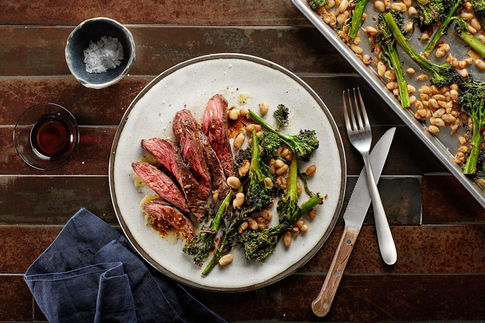 """This zesty vinaigrette gets used two ways: as a marinade for the steak and a sauce for serving. The steak cooks over the broccolini and white beans, flavoring them with its tasty juices. <a href=""""https://www.epicurious.com/recipes/food/views/sheet-pan-skirt-steak-with-balsamic-vinaigrette-broccolini-and-white-beans-56390002?mbid=synd_yahoo_rss"""" rel=""""nofollow noopener"""" target=""""_blank"""" data-ylk=""""slk:See recipe."""" class=""""link rapid-noclick-resp"""">See recipe.</a>"""