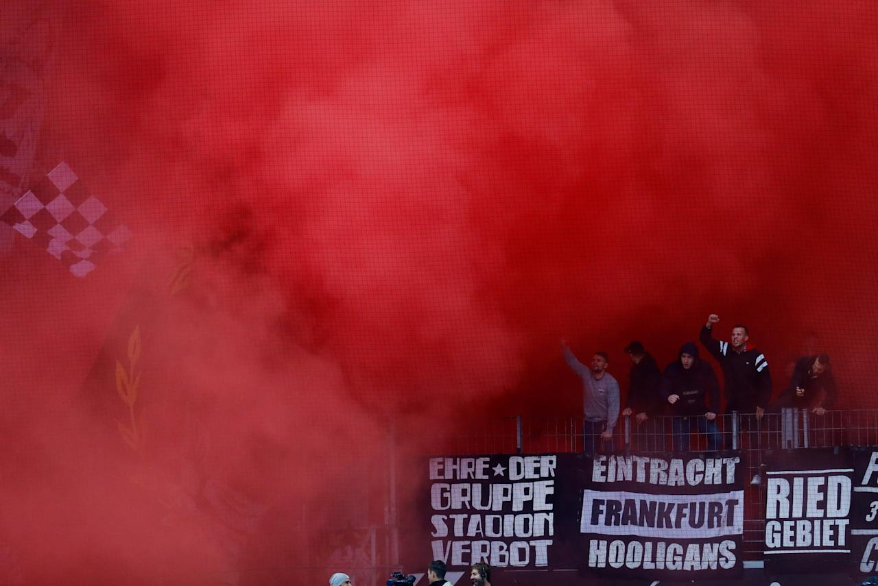 Soccer Football - Bundesliga - Eintracht Frankfurt vs Borussia Dortmund - Commerzbank-Arena, Frankfurt, Germany - October 21, 2017   Frankfurt fans let off smoke bombs and dislay banners before the match    REUTERS/Kai Pfaffenbach    DFL RULES TO LIMIT THE ONLINE USAGE DURING MATCH TIME TO 15 PICTURES PER GAME. IMAGE SEQUENCES TO SIMULATE VIDEO IS NOT ALLOWED AT ANY TIME. FOR FURTHER QUERIES PLEASE CONTACT DFL DIRECTLY AT + 49 69 650050