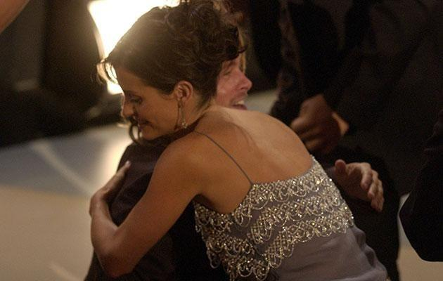 Brad and Courteney hug it out at the 2002 Emmys. Source: Getty