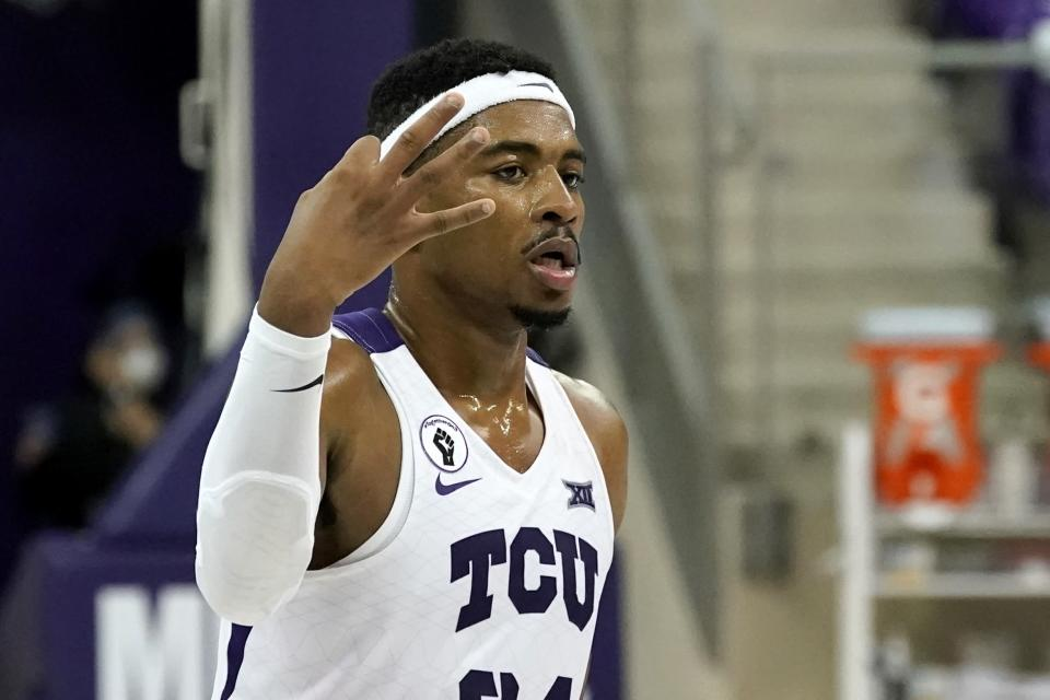 TCU forward Kevin Easley celebrates a 3-point basket during the second half of the team's NCAA college basketball game against North Dakota State in Fort Worth, Texas, Tuesday, Dec. 22, 2020. (AP Photo/Tony Gutierrez)