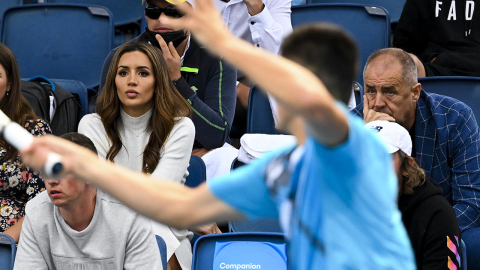 Vanessa Sierra and John Tomic, pictured here watching Bernard Tomic at the Australian Open.