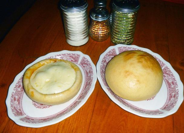 """<div class=""""caption-credit""""> Photo by: CATHY GALLANIS</div><b>Pizza Pot Pie</b> <br> <br> For the past 40 years, Chicago Pizza and Oven Grinder Company has been turning the city's signature deep-dish pizza on its head, literally. The restaurant's famous Pizza Pot Pie packs cheeses, house-made marinara sauce, choose-your-own veggies, and freshly ground pork sausage inside a large bowl topped with a sheet of triple-raised Sicilian bread dough. After a turn in a 500°F pizza oven, the golden-brown top is flipped upside-down tableside, the bowl is removed, and diners dig in. The restaurant, which reports serving more than 2,000 of these half-pounders per week, recommends one per person, since most people aren't fond of sharing."""