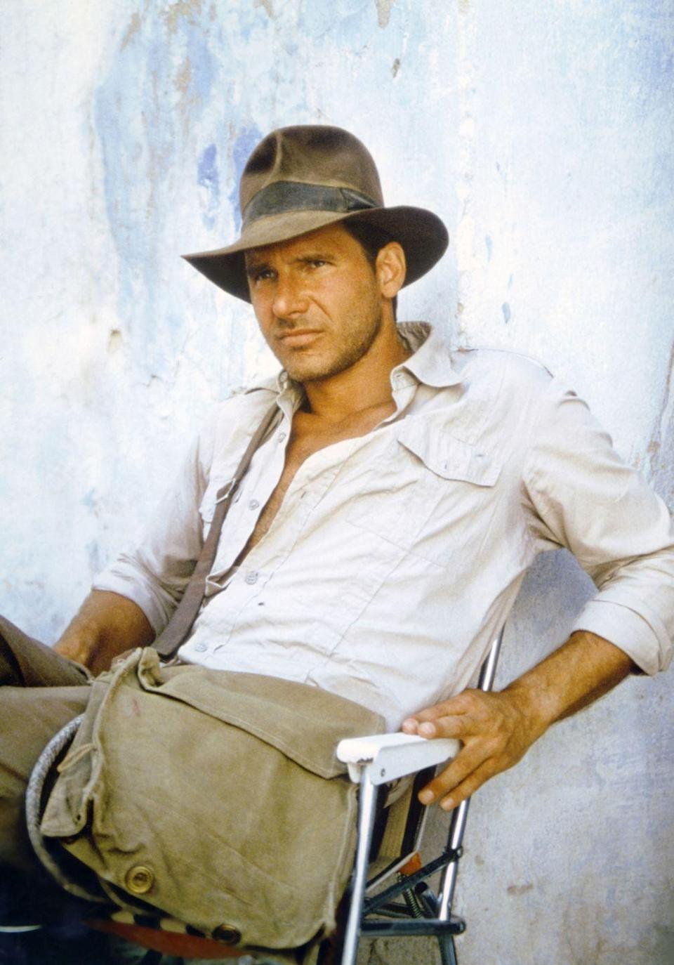 <p>Harrison Ford on the set of <em>Raiders of the Lost Ark</em>.</p>