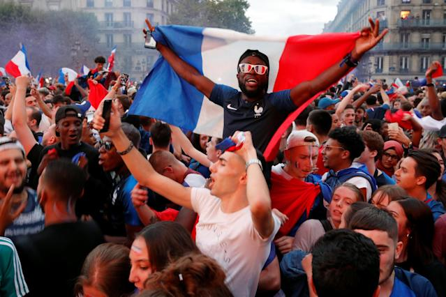 <p>Fans react in a fan zone at the Hotel de Ville after France defeated Belgium in the World Cup semi-final match. REUTERS/Philippe Wojazer </p>