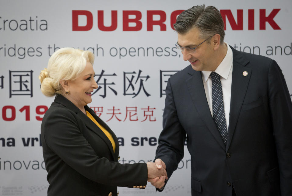Croatia's Prime Minister Andrej Plenkovic, right, welcomes his Romanian counterpart Viorica Dancila at the Summit of Central and Eastern Europe and China in Dubrovnik, Croatia, Friday, April 12, 2019. EU member Croatia is hosting a two-day summit between China and 16 regional countries on expanding business between China and the region, which is dubbed 16+1. (AP Photo/Darko Bandic)