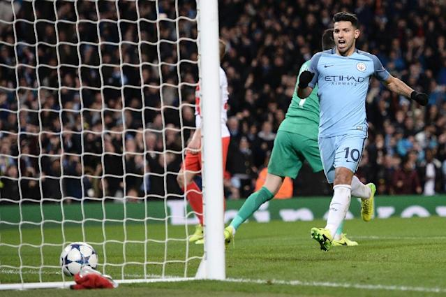 Manchester City's striker Sergio Aguero (R) celebrates scoring their second goal during the UEFA Champions League Round of 16 first-leg football match between Manchester City and Monaco at the Etihad Stadium in Manchester, on February 21, 2017 (AFP Photo/Oli SCARFF )