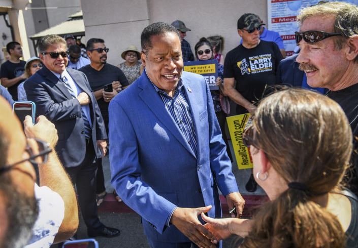 FILE — In this Sept. 7, 2021, file photo, Republican gubernatorial recall candidate Larry Elder, center, greets supporters before giving a speech in Clovis, Calif., in Fresno County. In the recall election, Gov. Gavin Newsom won big in coastal urban areas such as Los Angeles County, while the pro-recall effort performed better in the Central Valley and Northern California. Elder was the preferred replacement choice for voters who wanted Newsom removed from office. (Craig Kohlruss/The Fresno Bee via AP, File)