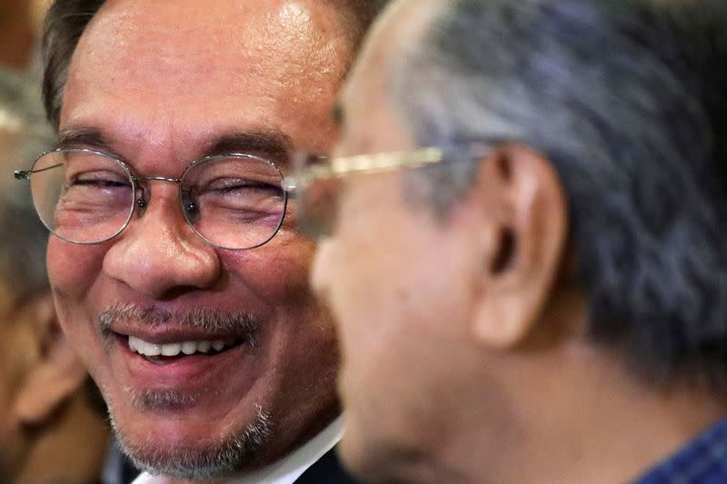 Explainer: New battle between old Malaysian rivals Mahathir and Anwar