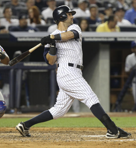New York Yankees' Nick Swisher watches his two-run home run during the seventh inning of a baseball game against the Texas Rangers on Tuesday, Aug. 14, 2012, at Yankee Stadium in New York. (AP Photo/Seth Wenig)