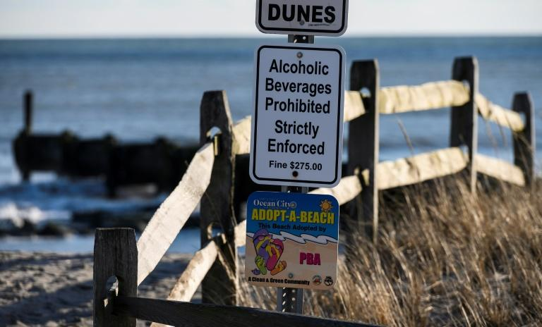 A sign on the boardwalk in Ocean City, New Jersey warns against drinking alcohol on the beach