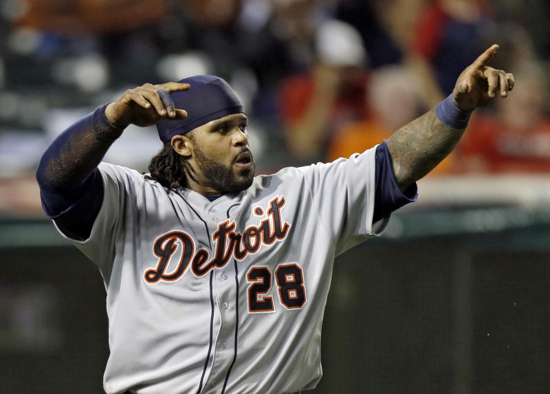 Detroit Tigers' Prince Fielder celebrates after scoring on Victor Martinez's two-run double in the 10th inning of a baseball game against the Cleveland Indians Monday, July 8, 2013, in Cleveland. (AP Photo/Mark Duncan)