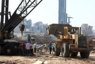 People work at the damaged site of Beirut port