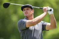 Bryson DeChambeau watches his tee shot on the third hole during the first round of the Wells Fargo Championship golf tournament at Quail Hollow Club on Thursday, May 6, 2021, in Charlotte, N.C. (AP Photo/Jacob Kupferman)