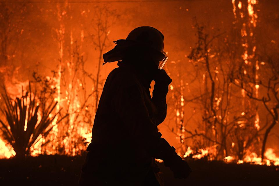NSW Rural Fire Service crews protect properties on Waratah Road and Kelyknack Road as the Wrights Creek fire approaches Mangrove Mountain north of Sydney.