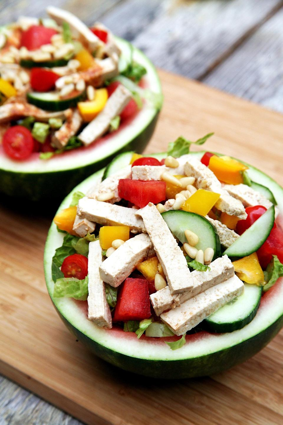 "<p>Colorful and perfect for summer, this delicious veggie-packed salad is best served in a hollowed-out watermelon half! The scooped-out flesh (which is your source of healthy carbs) will be put to good use in the dressing, with chunks mixed in alongside the lettuce, bell peppers, cucumbers, and tofu.</p> <p><strong>Get the recipe:</strong> <a href=""https://www.popsugar.com/fitness/Salad-Served-Watermelon-37755599"" class=""link rapid-noclick-resp"" rel=""nofollow noopener"" target=""_blank"" data-ylk=""slk:watermelon-bowl salad"">watermelon-bowl salad</a></p>"