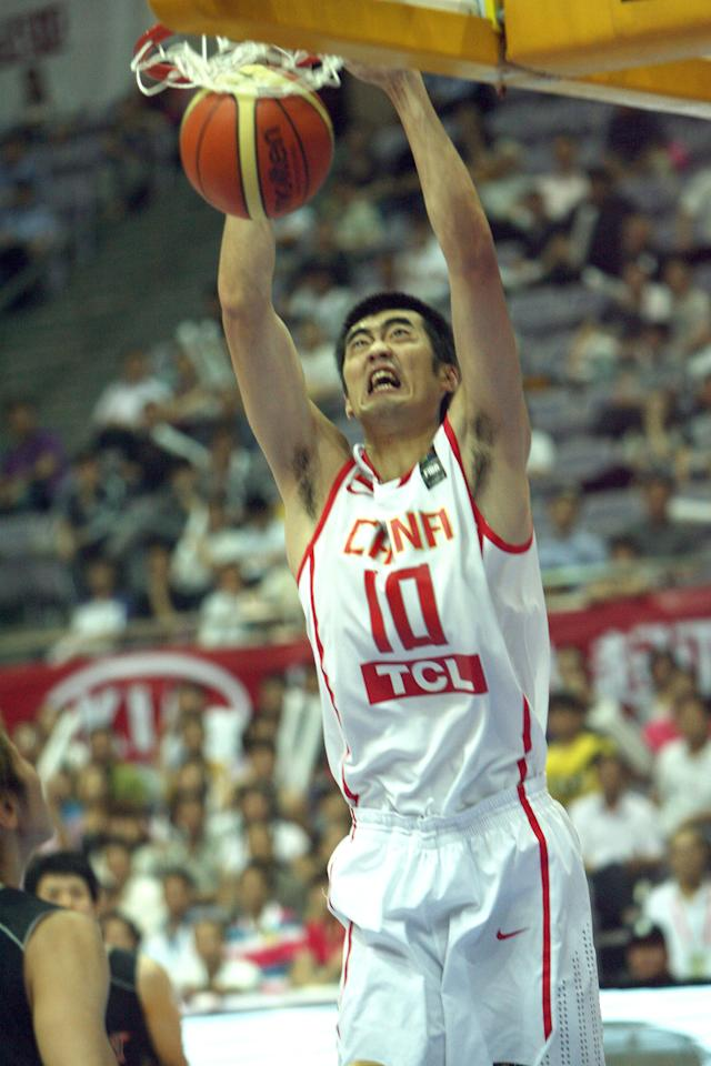 China's Zhang Zhaoxu slams dunk against Japan during the East Asia Basketball Championship in Nanjing, east China's Jiangsu province on June 14, 2011. Japan beat China 72-62. AFP PHOTO (Photo credit should read STR/AFP/Getty Images)