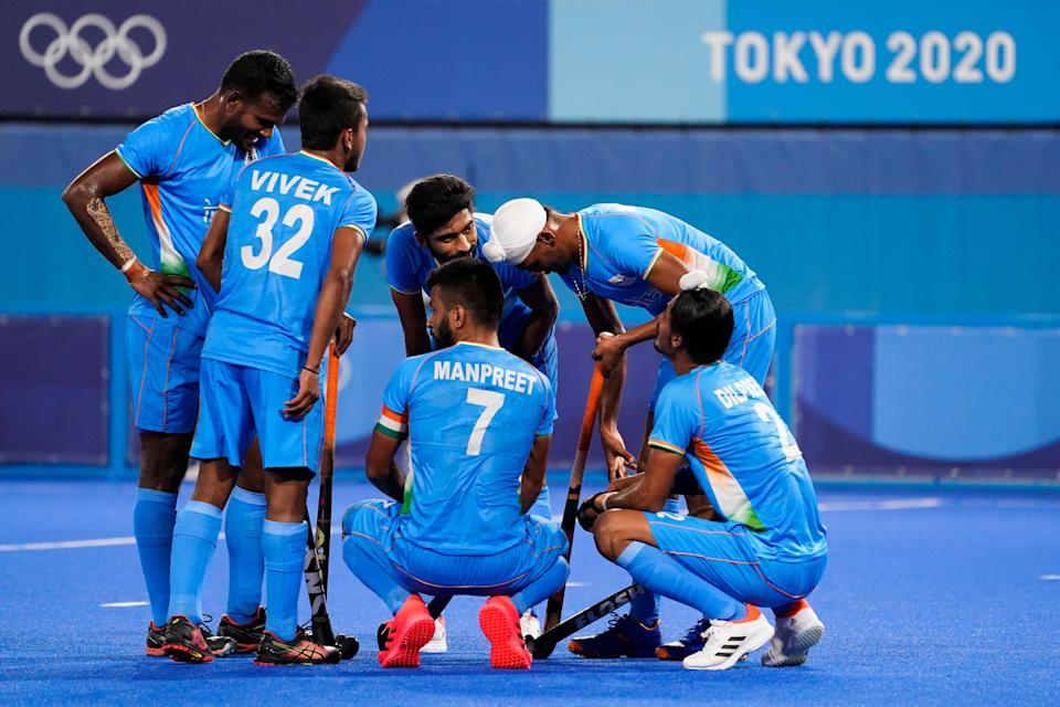 India's Manpreet Singh (7) huddles with his teammates after conceding the sixth goal to Australia (AP)