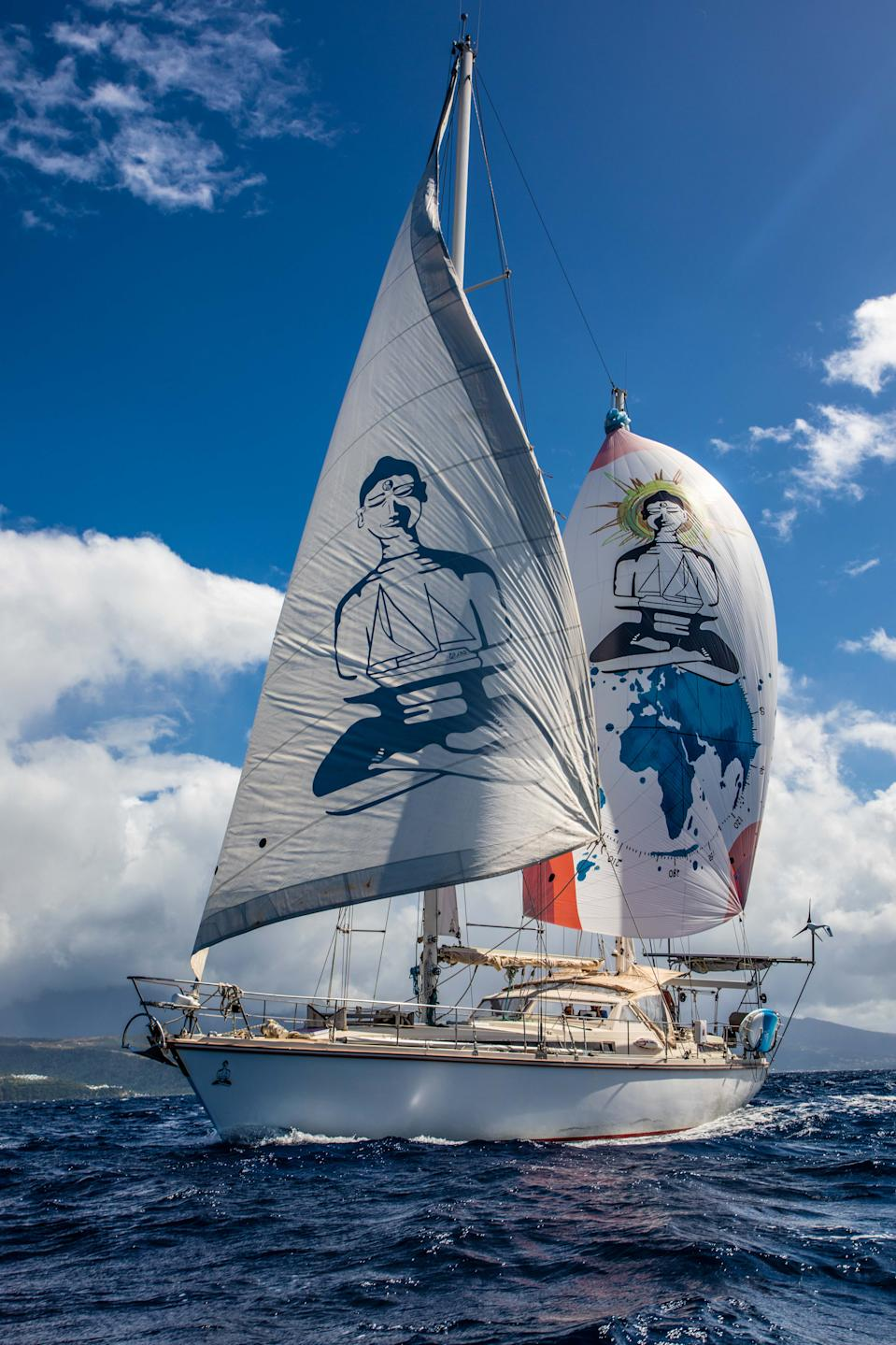 The distinctive Buddha sails of the SV Delos. (Photo courtesy SV Delos)