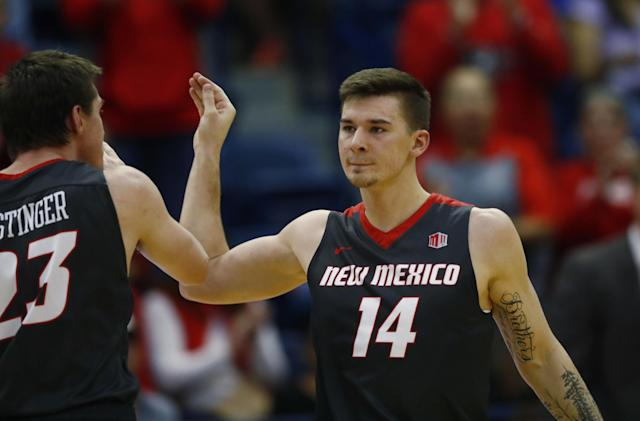 "New Mexico forward <a class=""link rapid-noclick-resp"" href=""/ncaab/players/126574/"" data-ylk=""slk:Joe Furstinger"">Joe Furstinger</a>, left, celebrates with guard Dane Kuiper late in the second half of an NCAA college basketball game against Air Force late, Wednesday, Feb. 8, 2017, at Air Force Academy, Colo. New Mexico won 74-67. (AP Photo/David Zalubowski)"
