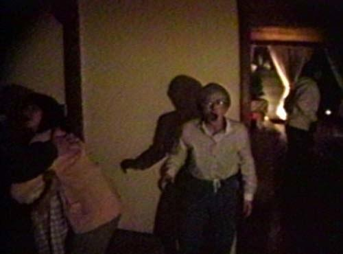 Home video of frightened family screaming