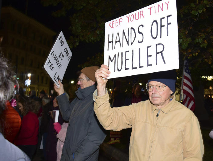 <p>People participate in a public rally at Park Square to protect special counsel Robert Mueller's investigation into potential coordination between Russia and President Trump's campaign in the wake of Attorney General Jeff Sessions's resignation Thursday, Nov. 8, 2018, in Pittsfield, Mass. (Photo: Gillian Jones/The Berkshire Eagle via AP) </p>
