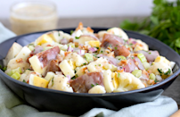 """<p>You don't always have to use mayonnaise to make a creamy potato salad; this recipe proves it with ranch dressing. Cauliflower, bacon and hard-boiled eggs are also added for extra texture and flavor in this hearty side dish.</p> <p><a href=""""https://www.thedailymeal.com/best-recipes/creamy-ranch-potato-salad?referrer=yahoo&category=beauty_food&include_utm=1&utm_medium=referral&utm_source=yahoo&utm_campaign=feed"""" rel=""""nofollow noopener"""" target=""""_blank"""" data-ylk=""""slk:For the Creamy Ranch Potato and Cauliflower Salad recipe, click here."""" class=""""link rapid-noclick-resp"""">For the Creamy Ranch Potato and Cauliflower Salad recipe, click here.</a></p>"""