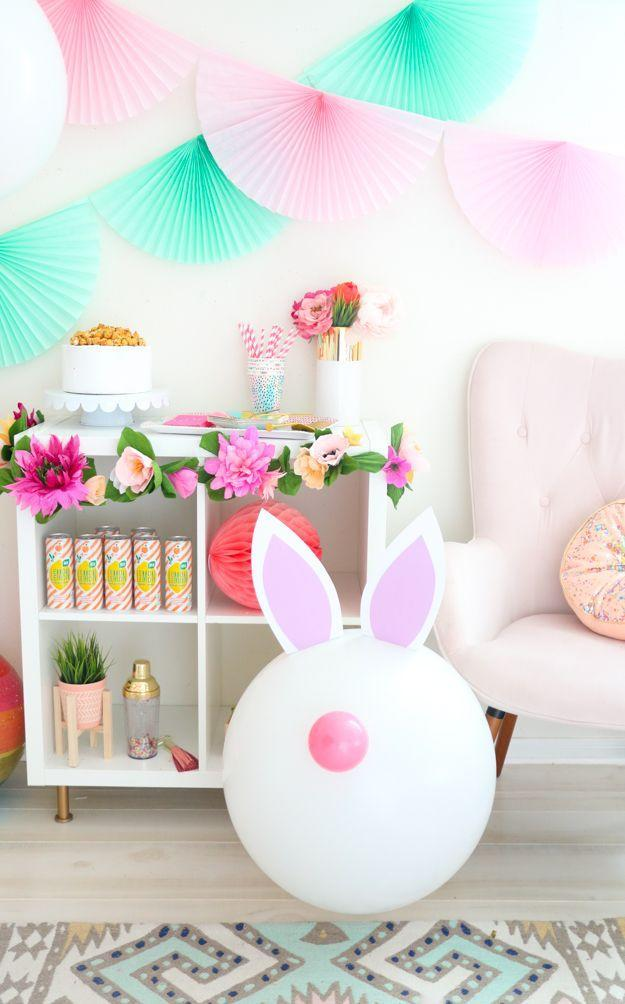 """<p>The little ones at your party will get a kick out of these bouncy Easter decorations. All you need are giant balloons and card stock for the ears. </p><p><em><a href=""""https://akailochiclife.com/2018/03/giant-easter-bunny-balloons.html"""" rel=""""nofollow noopener"""" target=""""_blank"""" data-ylk=""""slk:Get the tutorial at A Kailo Chic Life »"""" class=""""link rapid-noclick-resp"""">Get the tutorial at A Kailo Chic Life »<br></a></em></p>"""