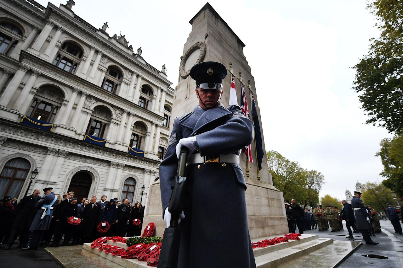<p>People observe two minutes silence during a service at the Cenotaph to mark Armistice Day in London, Britain, Nov. 11, 2017. (Photo: Andy Rain/EPA-EFE/REX/Shutterstock) </p>