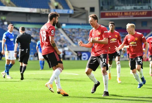 Bruno Fernandes and Manchester United celebrate their last-gasp winner as Brighton's Lewis Dunk speaks to referee Chris Kavanagh