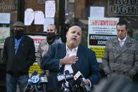 Attorney Louis Gelormino speaks outside Mac's Public House during a press conference outside the closed bar on Staten Island Monday, Dec. 7, 2020, in New York. Authorities in New York City said Danny Presti, the co-owner of the bar that was defying coronavirus restrictions, was arrested early Sunday, Dec. 6 after running over a deputy with his car. (AP Photo/Eduardo Munoz Alvarez)