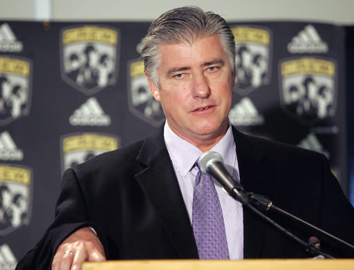FILE - In this Oct. 20, 2005, file photo, Sigi Schmid talks to reporters after he was hired to be the head coach of the Columbus Crew MLS soccer team in Columbus, Ohio. Nearly two years after he died, Schmids presence and influence is being heavily felt heading into Saturdays MLS Cup final between Columbus and Seattle. (AP Photo/Kiichiro Sato, File)