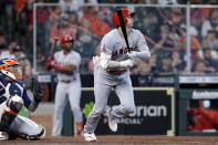 Los Angeles Angels designated hitter Shohei Ohtani, right, watches his home run hit in front of Houston Astros catcher Martin Maldonado, left, during the eighth inning of a baseball game Sunday, April 25, 2021, in Houston. (AP Photo/Michael Wyke)