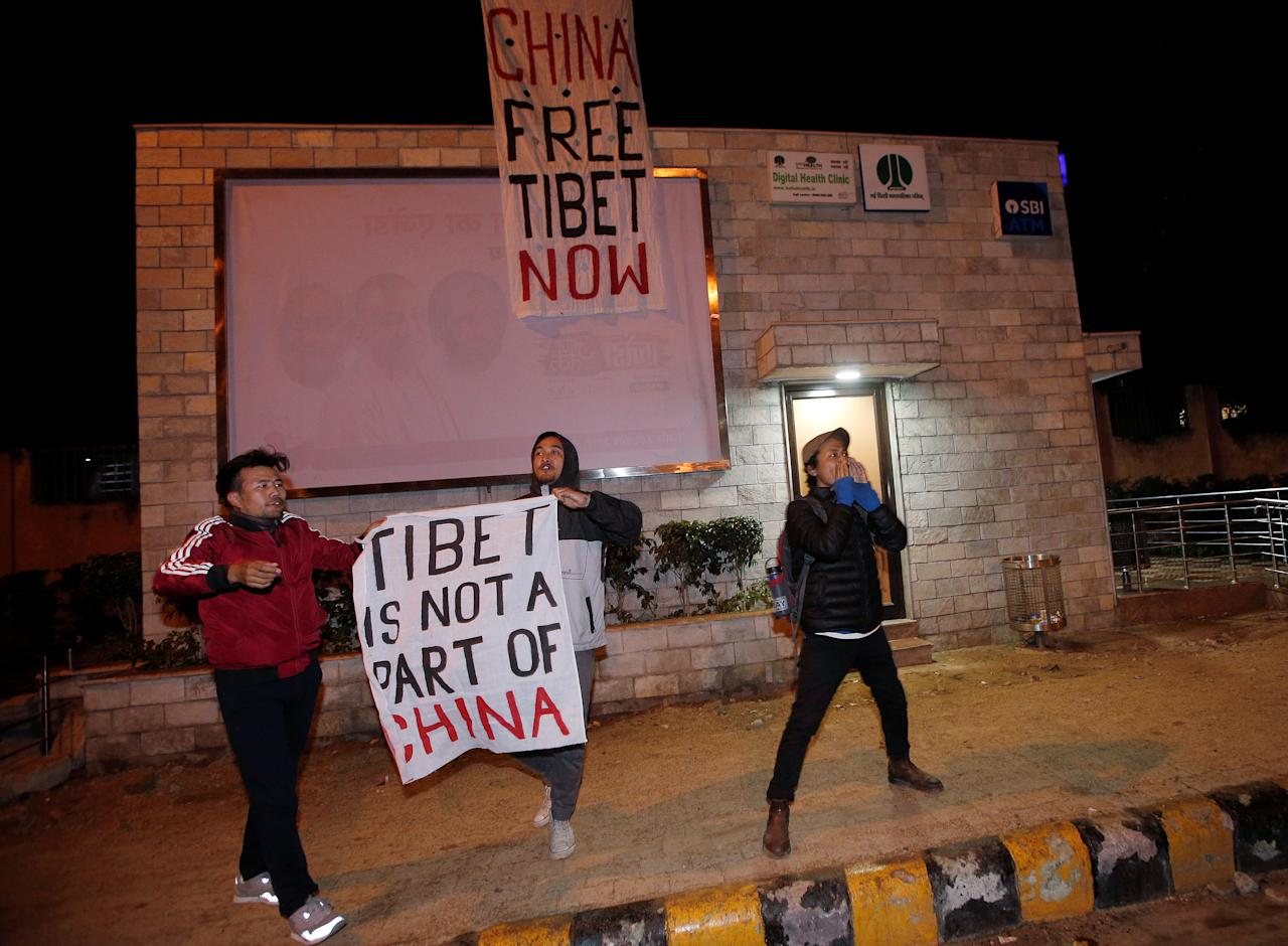 Tibetan exiles hold banners as they shout slogans during a protest against the visit of Chinese Foreign Minister Wang Yi to India, outside the hotel where Yi is staying, in New Delhi, India, December 11, 2017. REUTERS/Adnan Abidi