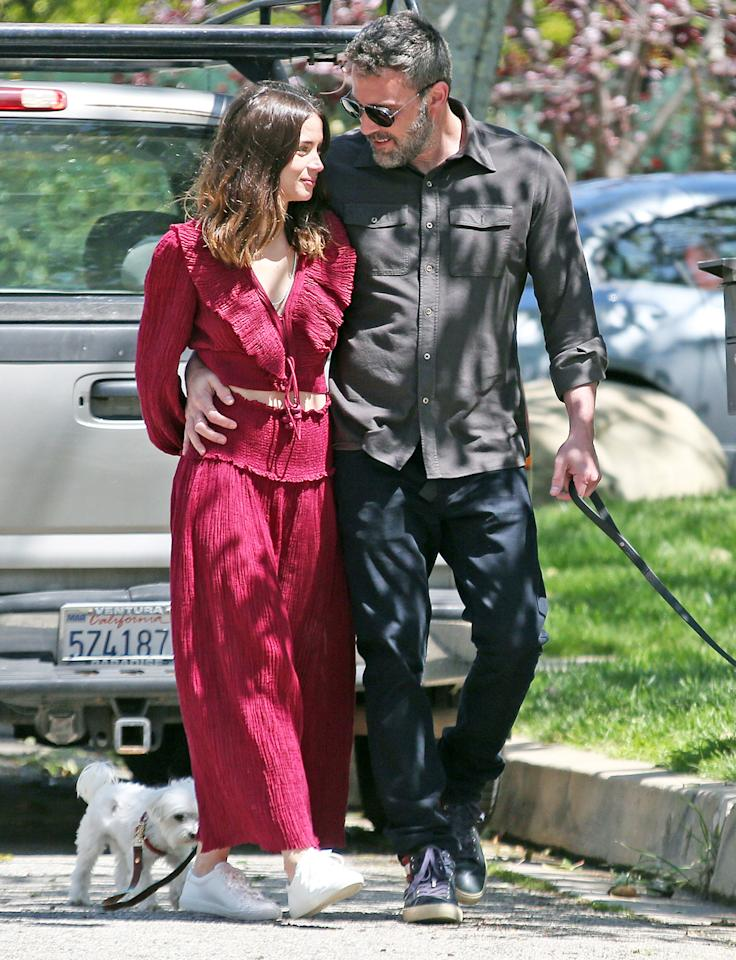 """<p>The <em>Deep Water</em> costars first sparked relationship rumors in early March during their <a href=""""https://people.com/movies/ben-affleck-ana-de-armas-costa-rica-dating/"""">romantic vacation</a> in de Armas' native Cuba, as well as in Costa Rica.</p> <p>Since their return, the couple has been in self-quarantine together in Los Angeles, where they've made daily PDA-packed walks with de Armas' dogs.</p> <p>""""They seem to have a great time together,"""" a source <a href=""""https://people.com/movies/ben-affleck-and-ana-de-armas-are-social-distancing-together-at-his-house-they-have-a-great-time/"""">told PEOPLE</a> of the loved-up actors. """"They order delivery food and groceries and only leave the house for walks around the neighborhood with their dogs. Ben looks incredibly happy. They are flirty and goofy. Ana always has a huge smile around him.""""</p>"""