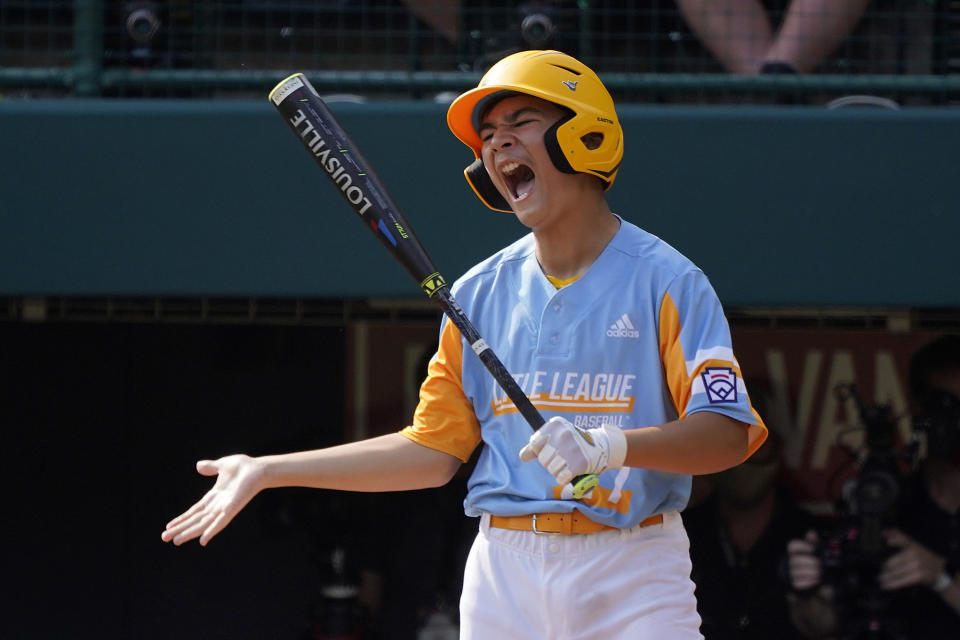 Honolulu, Hawaii's Ryan Keanu reacts to swinging at a third strike from Taylor, Mich., starting Cameron Thorning to end the third inning of a baseball game at the Little League World Series in South Williamsport, Pa., Saturday, Aug. 28, 2021. (AP Photo/Gene J. Puskar)