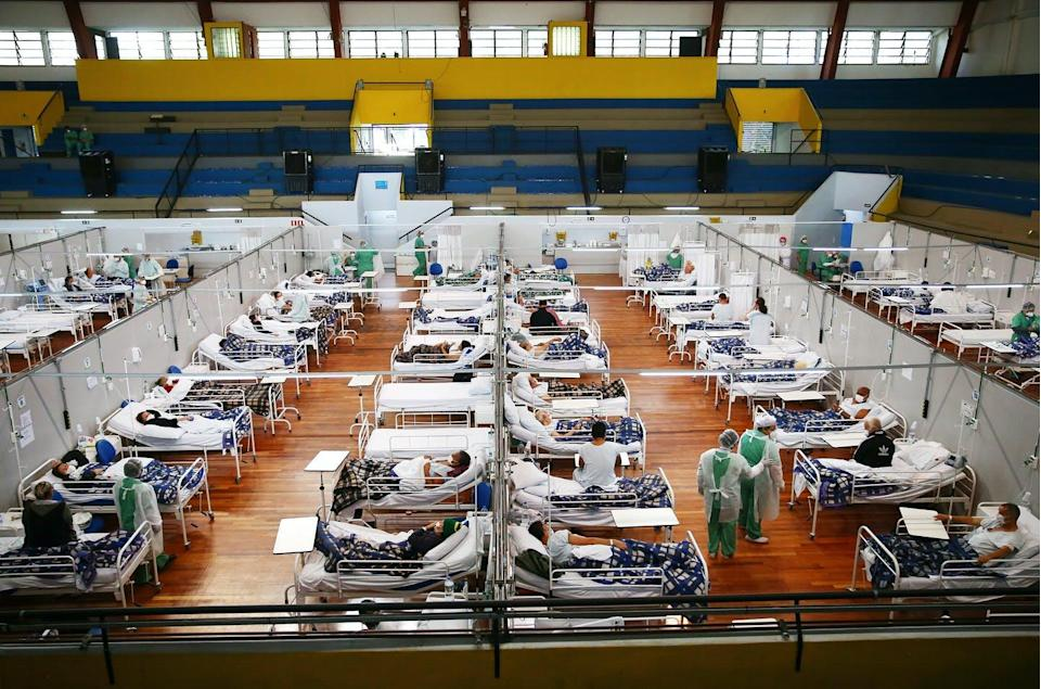 """<span class=""""caption"""">A COVID-19 field hospital in Santo Andre, Brazil. The pandemic has killed over 503,000 people in Brazil; just 11% of the population is fully vaccinated. </span> <span class=""""attribution""""><a class=""""link rapid-noclick-resp"""" href=""""https://www.gettyimages.com/detail/news-photo/health-care-workers-care-for-covid-19-patients-at-a-field-news-photo/1318545805?adppopup=true"""" rel=""""nofollow noopener"""" target=""""_blank"""" data-ylk=""""slk:Mario Tama/Getty Images"""">Mario Tama/Getty Images</a></span>"""