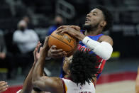 Detroit Pistons guard Josh Jackson and Cleveland Cavaliers guard Collin Sexton battle for control during the second half of an NBA basketball game, Monday, April 19, 2021, in Detroit. (AP Photo/Carlos Osorio)