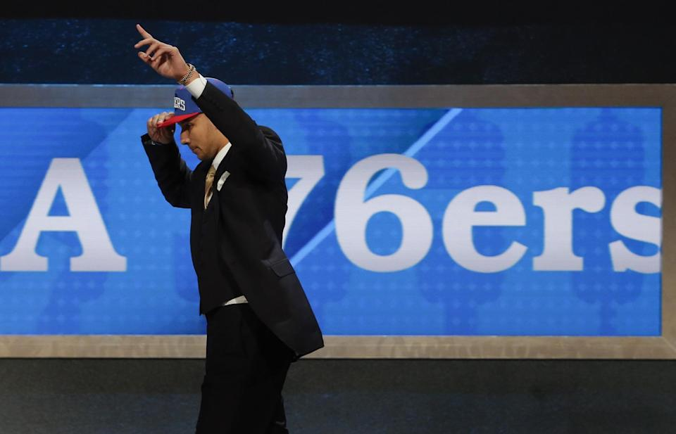 LSU's Ben Simmons raises his hand as he walks off the stage after being selected as the top pick by the Philadelphia 76ers during the NBA basketball draft, Thursday, June 23, 2016, in New York. (AP Photo/Frank Franklin II)