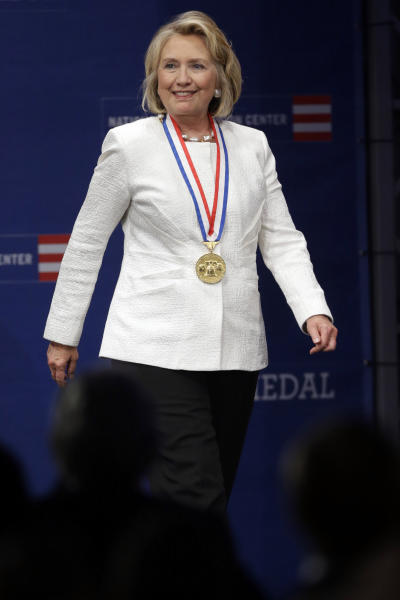 Former Secretary of State Hillary Rodham Clinton walks to the podium after receiving the Liberty Medal during a ceremony at the National Constitution Center, Tuesday, Sept. 10, 2013, in Philadelphia. The honor is given annually to an individual who displays courage and conviction while striving to secure liberty for people worldwide. (AP Photo/Matt Rourke)