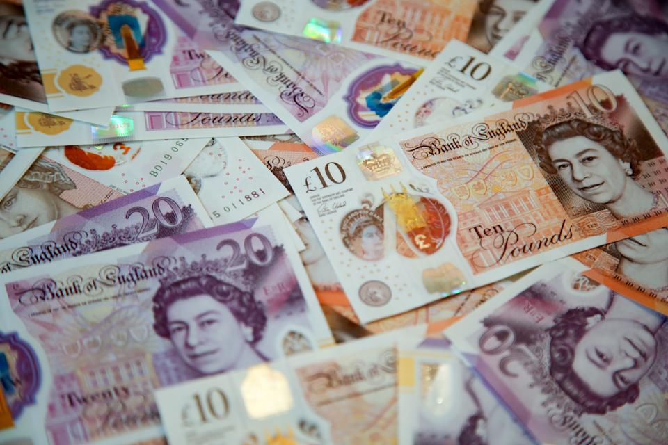 In this photo illustration, a collection of British ten and twenty pound sterling banknotes are displayed. (Photo by Dinendra Haria / SOPA Images/Sipa USA)
