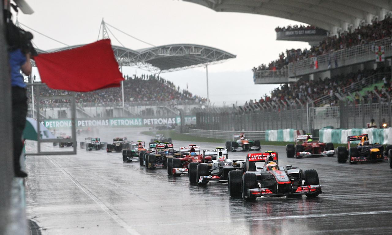 Formula One race cars line up during Formula One's Malaysian Grand Prix at the Sepang International Circuit in Sepang on March 25, 2012  AFP PHOTO / POOL / DITA ALANGKARA (Photo credit should read DITA ALANGKARA/AFP/Getty Images)