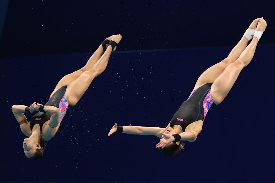 Malaysia's Leong Mun Yee and Pandelela Rinong in action during the women's 10m synchronised final at the Tokyo Aquatics Centre July 27, 2021. — Reuters pic