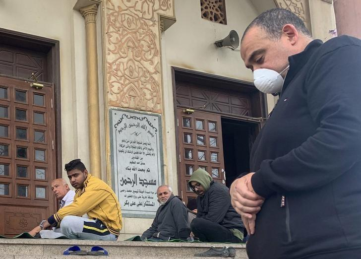 A man wearing a protective mask as a measure of prevention against the coronavirus disease (COVID-19) attends Friday prayers outside Abdel Rahman Mosque in the Cairo neighborhood Maadi