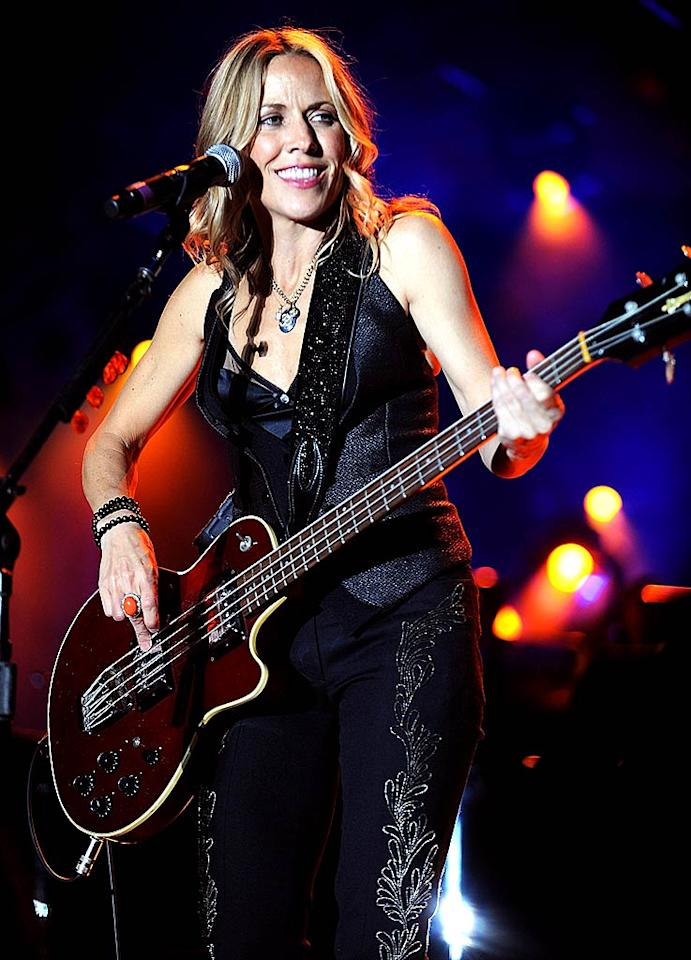"Sheryl Crow entertains the audience with a multitude of hits, including ""Soak Up the Sun"" and ""All I Wanna Do."" Kevin Mazur/<a href=""http://www.wireimage.com"" target=""new"">WireImage.com</a> - October 11, 2008"